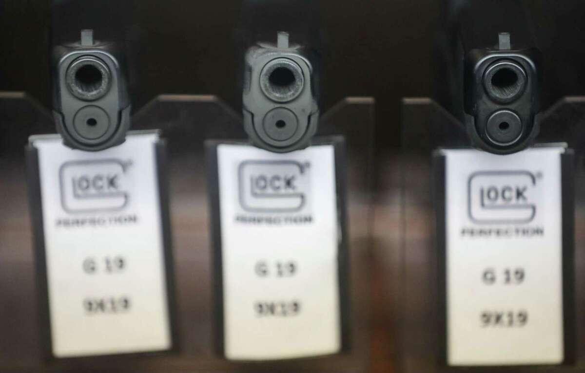 Three Glock 19 pistols are for sale Monday, Aug. 30, 2021, at Top Gun Range in Houston.