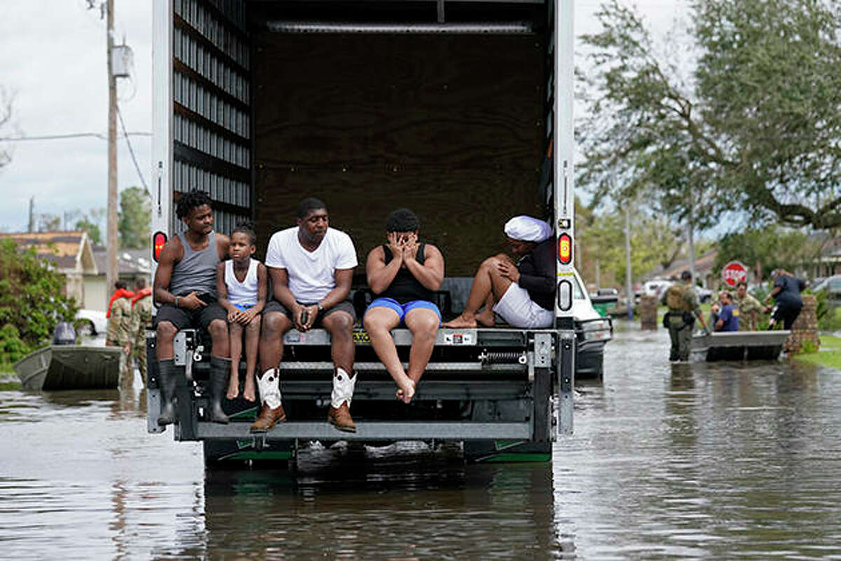 People are evacuated from floodwaters in the aftermath of Hurricane Ida in LaPlace, Lousiana.