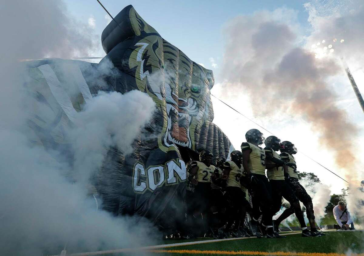 Conroe players take the field before a non-district high school football game at Buddy Moorhead Stadium, Friday, Aug. 27, 2021, in Conroe.