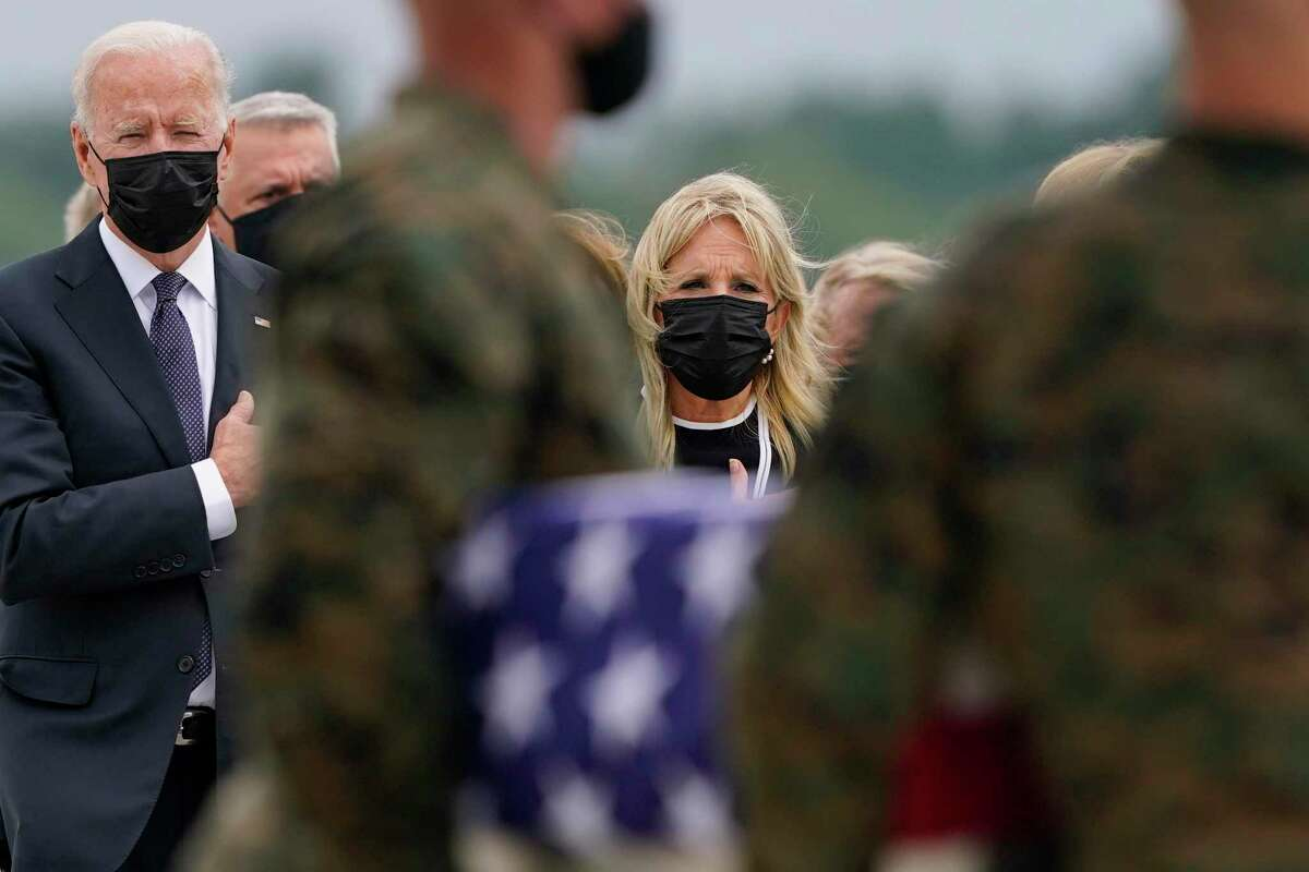 President Joe Biden and first lady Jill Biden look on as the remains of service members killed in the Kabul airport bombing are brought home. Biden's presidency has never been shakier with the American public.