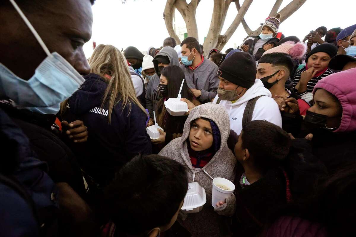 Asylum-seekers receive food as they wait in Tijuana, Mexico, in February. This is no way to humanely honor due process.