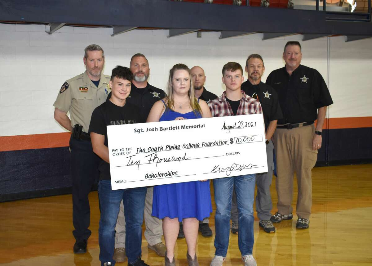 The South Plains College Foundation presents a ceremonial check to the Bartlett family to establish the Sgt. Joshua Bartlett Memorial Scholarship.