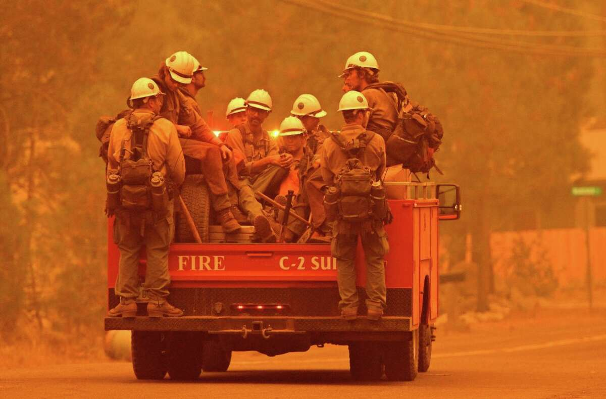 Firefighters arrive at the scene as flames from the Caldor Fire push into South Lake Tahoe, Calif., on Aug. 30, 2021.