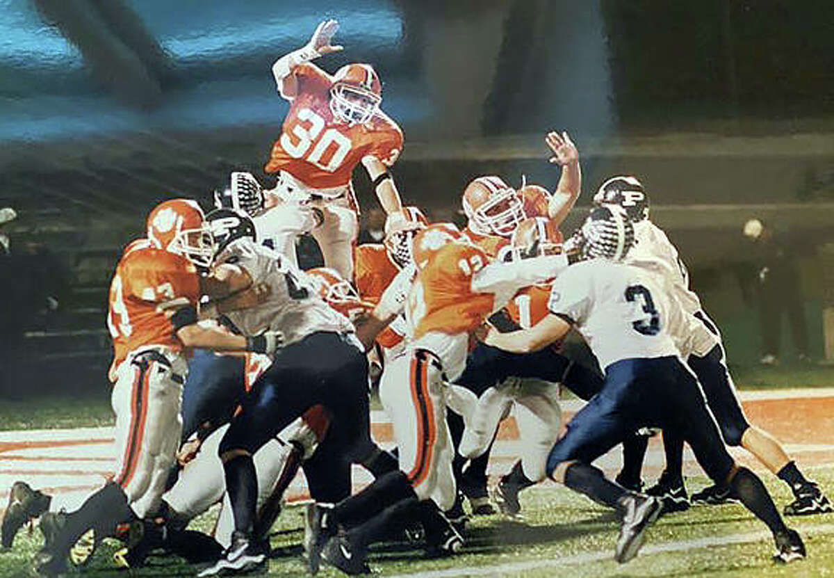 Edwardsville's Ricky Ricciardi, top, tries to block an extra point during the Class 7A championship against Mount Prospect in 2001.