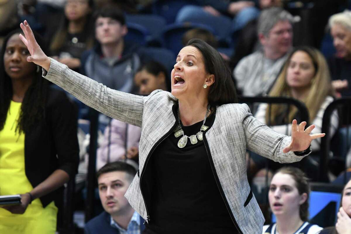 Connecticut Sun President Jennifer Rizzotti, formerly head coach of the George Washington Colonials, signals to her players during a women's college basketball game against the Richmond Spiders in February 2020 in Washington, D.C.