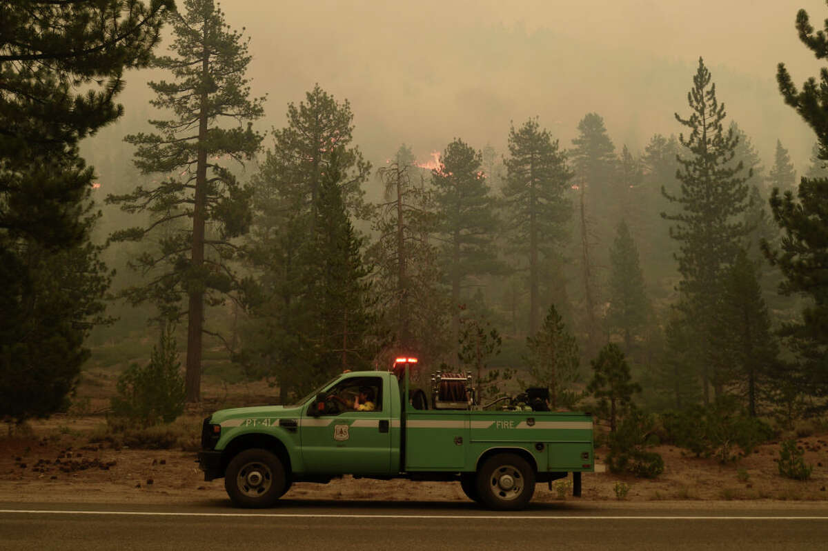 Fire crews get prepared to respond the Caldor Fire as it moves closer to South Lake Tahoe, Calif., on Aug. 30, 2021.