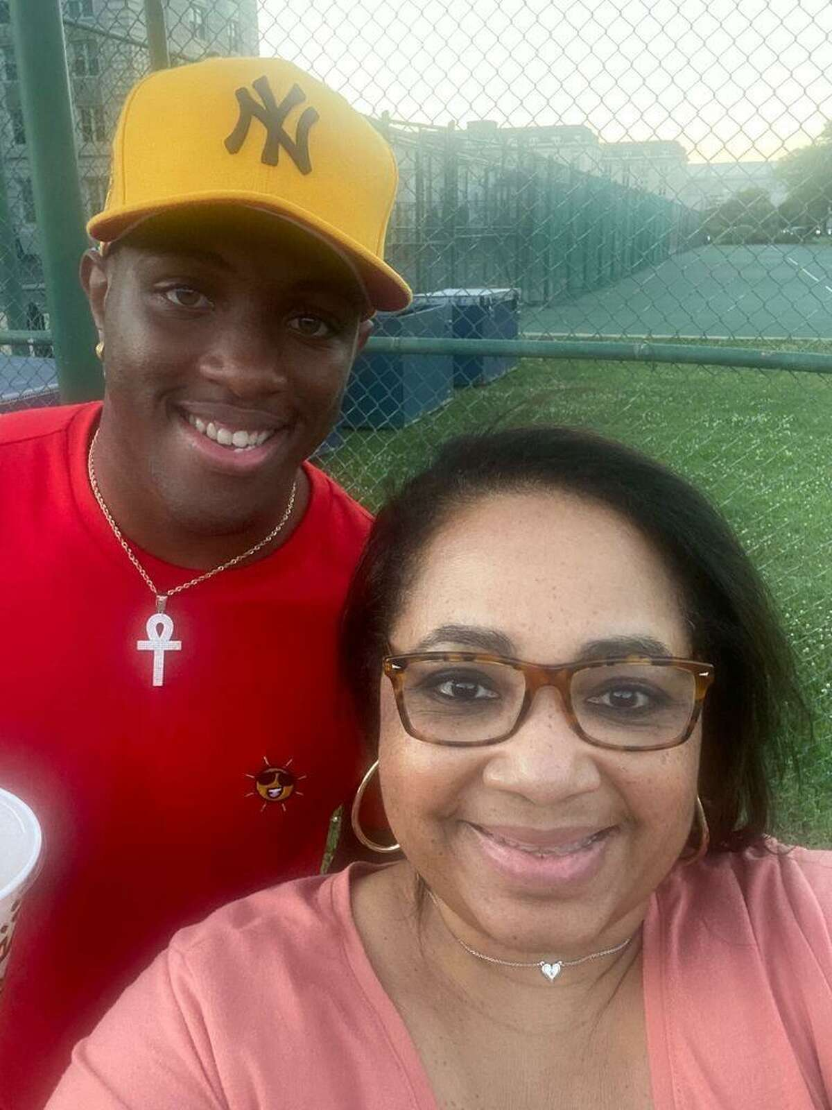 Police in Maryland have arrested a 29-year-old man and charged him with murder in the death of Michelle Cummings, a Houston woman who was fatally shot on a restaurant patio after dropping off her son at the U.S. Naval Academy, authorities said Wednesday.