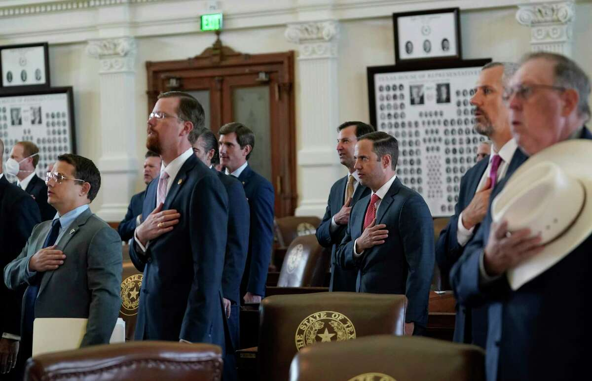 Texas State Representatives join in the pledge in the House Chamber at the Texas Capitol as they prepare to debate voting bill SB1, Thursday, Aug. 26, 2021, in Austin, Texas. (AP Photo/Eric Gay)