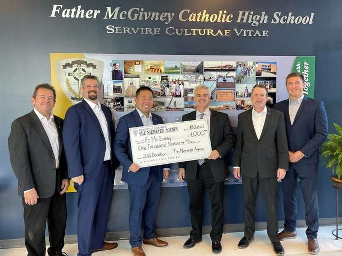 The Niemeyer Agency recently presented Father McGivney Catholic High School an annual donation. Pictured are, from left, Eric Diekemper, Greg Mehochko, Jeff Niemeyer, Father McGivney Principal Joseph Lombardi, Michael Sullivan and Landon Schroeder.