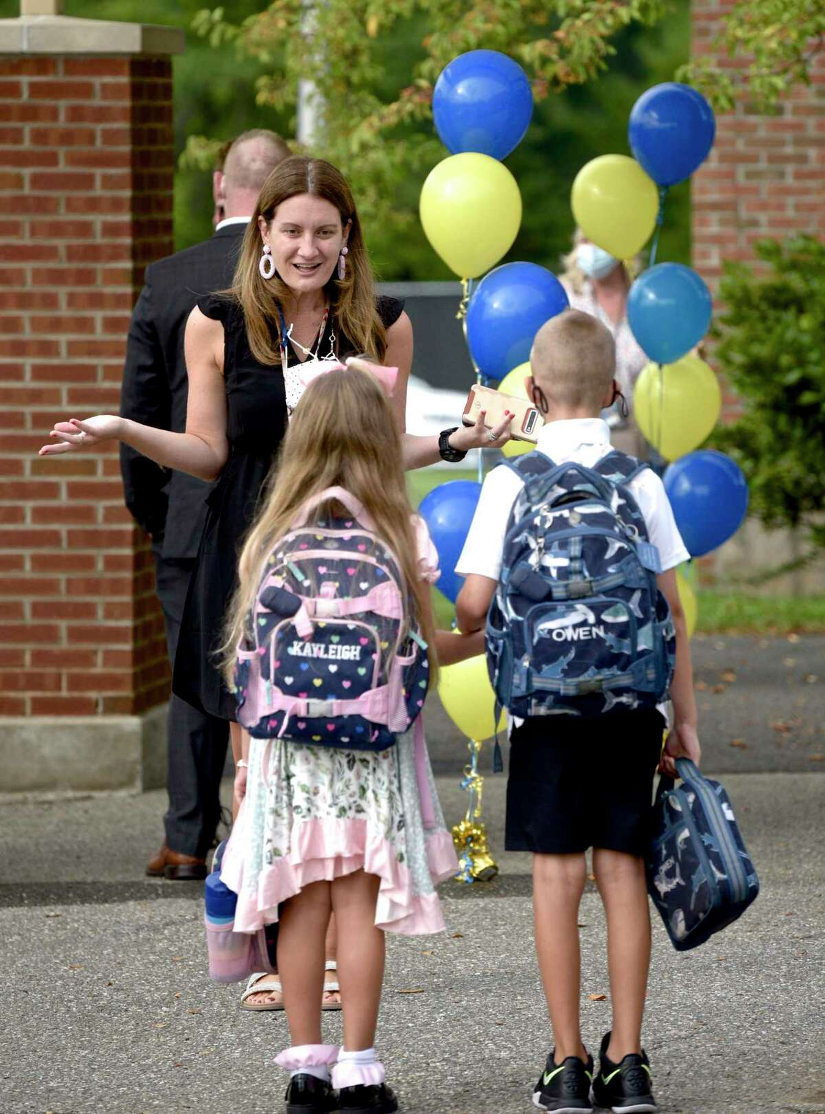 Principal Melissa Labrosciano welcomes student back on the first day of new school year at Huckleberry Hill School, Brookfield, Conn. Tuesday, August 31, 2021.