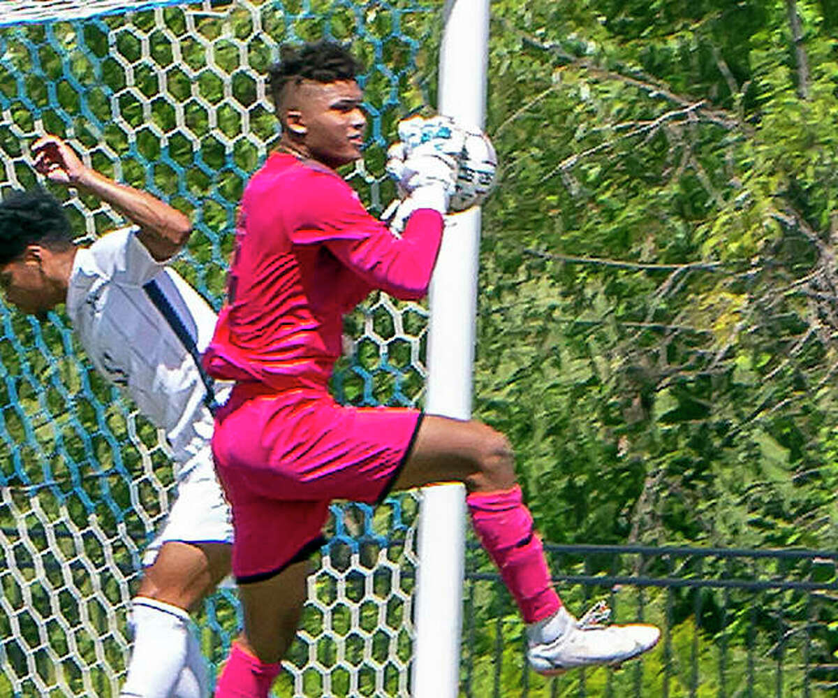 LCCC goalie Eric Walker makes a save in front of a Johnson County College player during Sunday's game at Tim Rooney Stadium in Godfrey.