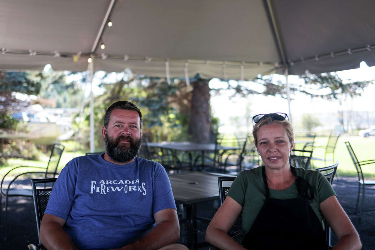"""(From left) Jim and Brandy Stoops are the owners of Ketch-22, a food truck that opened in Arcadia on July 3. It serves locally sourced food, including seafood, vegetarian and vegan options but is generally American cuisine that has been """"twisted up a little,"""" according to co-owner Jim Stoops. It is located on State Street/M-22 in between the Arcadia Marshes and the marina."""