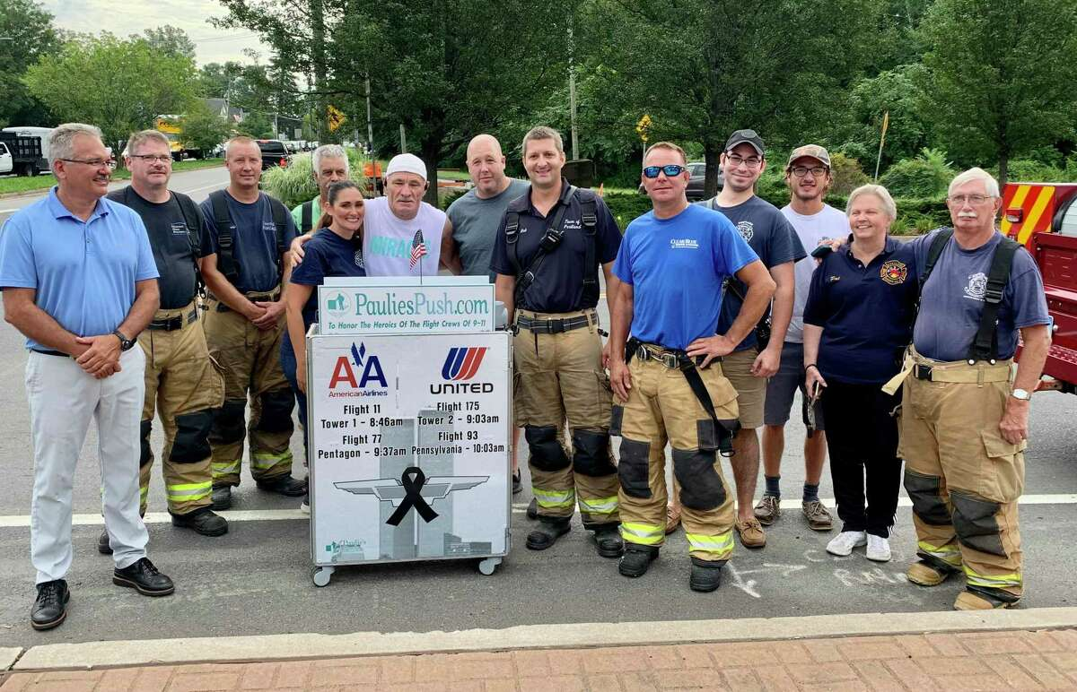 Paul Veneto was greeted by members of the Portland Fire Department as he made his journey from Boston to Ground Zero in New York City to commemorate flight attendants who died in the 9/11 terrorist attacks.