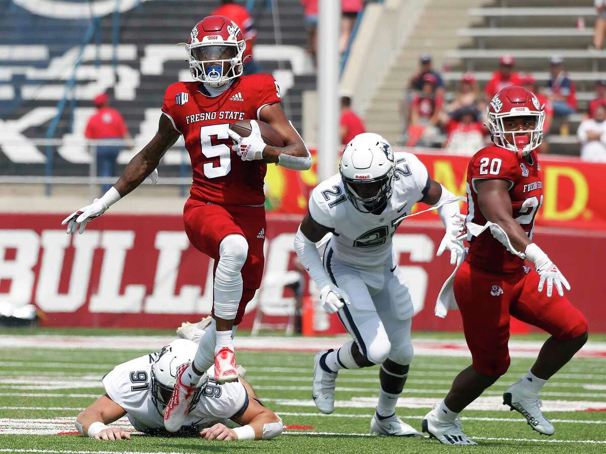 Fresno State's Jalen Cropper (5) runs past UConn's Collin McCarthy (91) during the first half of an NCAA football game in Fresno, Calif., on Aug. 28.