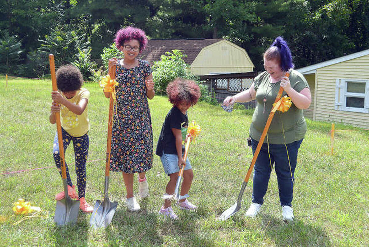 Faith Jordan, right, with her daughters Elizabeth, Abigail and CJ during Sunday afternoon's groundbreaking ceremony on the site of Jordan's future Habitat for Humanity home in Edwardsville.