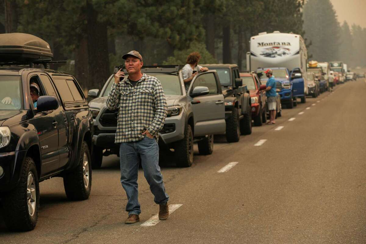 An evacuation line begins to form on Highway 50 in South Lake Tahoe, Calif. Despite some cautious optimism among fire crews about the state of the Caldor Fire, fire officials said it will be some time before residents of the region's largest city are allowed to return home.