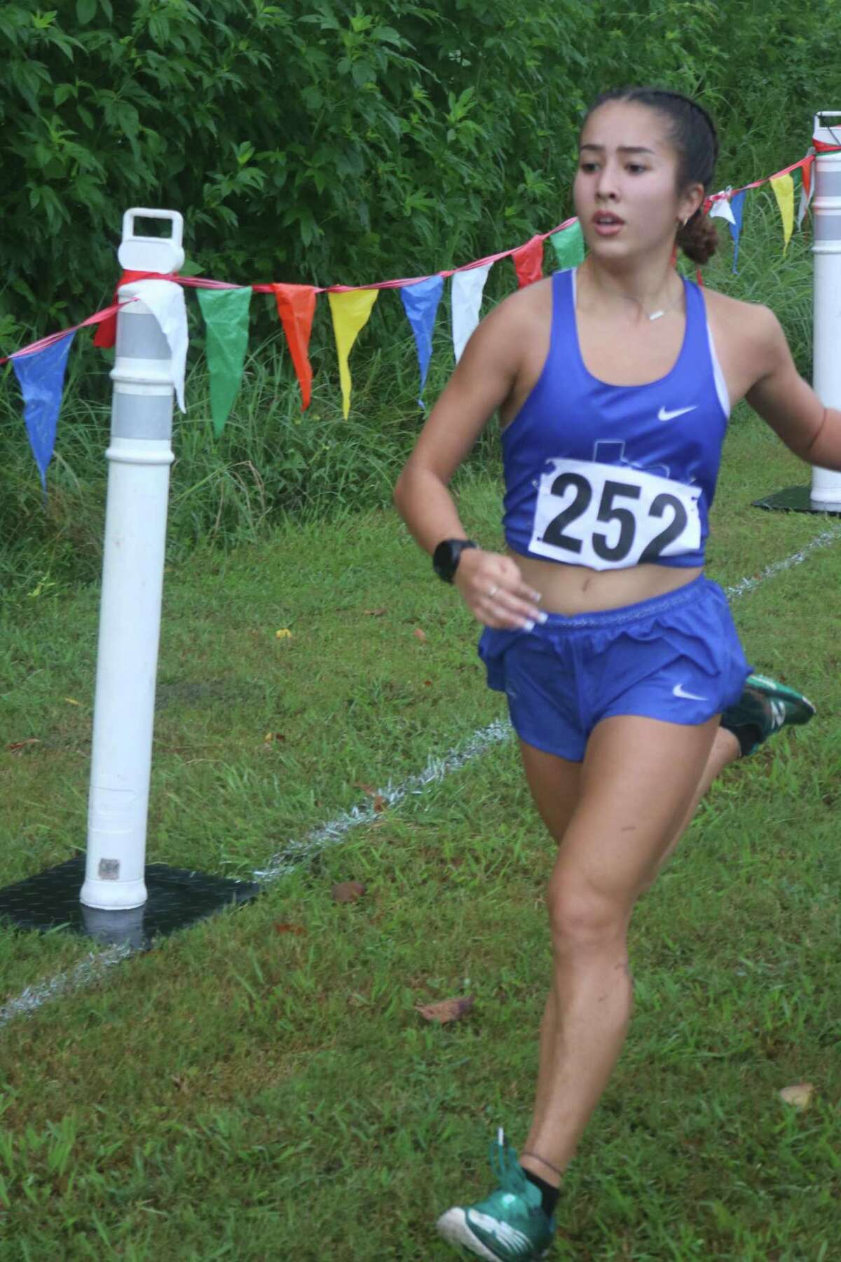 Clear Springs' Ami Clark prepares to reach the finish line, securing her first-place effort at last Friday morning's Clear Creek Invitational. She secured the time of 20:16 in less than ideal running conditions.