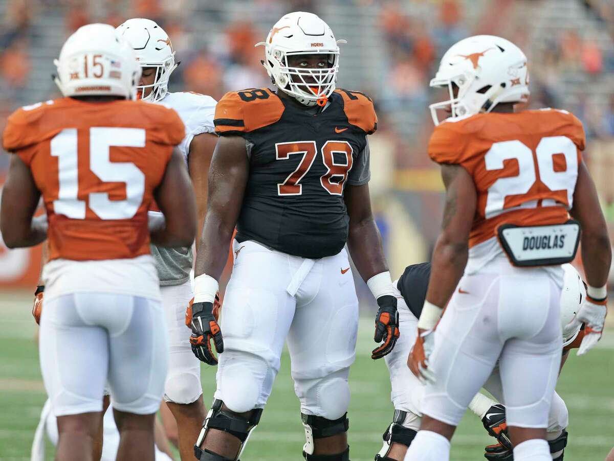 Offensive lineman Denzel Okafor, seen here the Texas spring game in 2018, will undergo season-ending surgery this week.