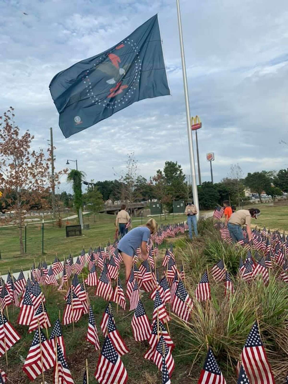 Boy Scouts place American flags at the Montgomery County Veteran's Memorial Park under the First Responders Flag at the park. On Sept. 11 the flag will be lowered in recognition of those who lost their life in the terror attacks of Sept. 11, 2001.