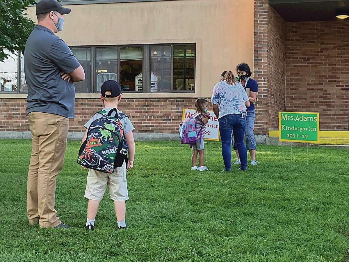 Kindergarten teacher Allison Veine introduces herself to a student at Jefferson Elementary Tuesday morning. (Courtesy photo)
