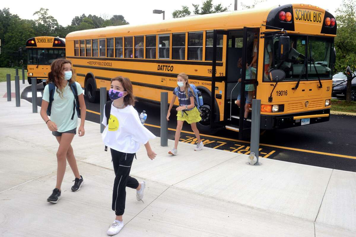 Students arrive for the first day of classes at Coleytown Middle School, in Westport, Conn. Aug. 31, 2021.