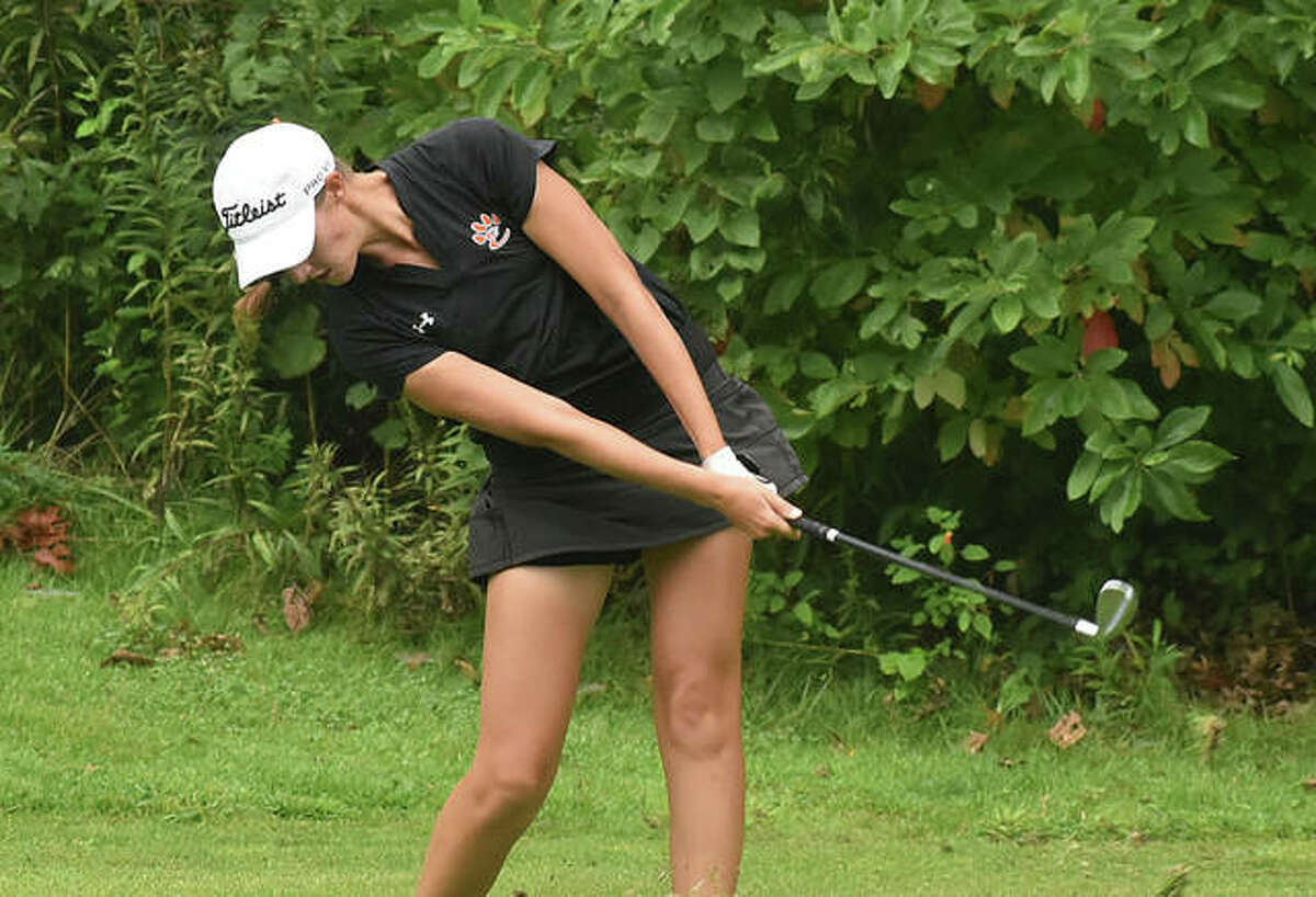 Edwardsville's Nicole Johnson follows through on her tee shot on No. 8 at Far Oaks Golf Club during the first round of the Southwestern Conference Tournament on Tuesday in Caseyville.