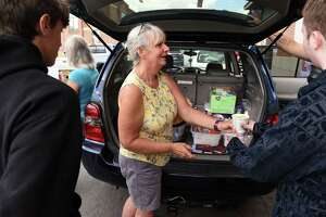 Pastor Brenda Tompkins of the Mechanicville United Methodist Church serves food to Saratoga needy during weekly outreach stop on Tuesday, Aug. 31, 2021, on Woodlawn Ave. in Saratoga Springs, N.Y. Dave Santy of Mechanicville runs an informal outreach to people who are homeless or in need every Tuesday at noon.