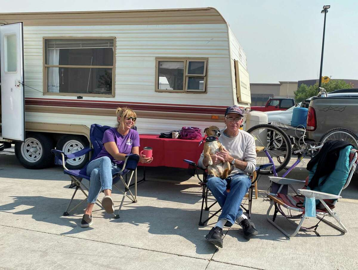South Lake Tahoe resident Leia Sutton and her dad Lee, who lives in Meyers, at the camp they setup outside the Walmart in Gardnerville, Nevada.