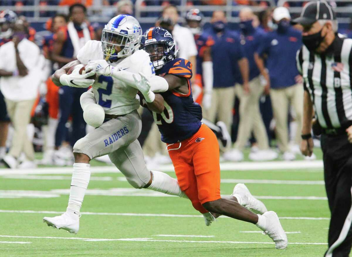 UTSA's Tariq Woolen (20) stops Middle Tennessee's Jayy McDonald (02) from breaking away for a touchdown in the second half during their game at the Alamodome on Friday, Sept. 25, 2020. UTSA wins, 37-35, over Middle Tennessee.