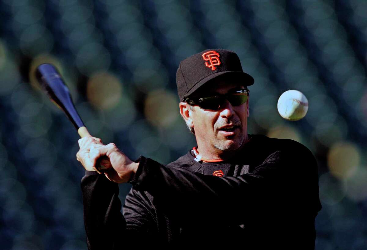 Ron Wotus, one of the San Francisco Giants' new coaches this year, takes part in warm-ups prior to the Giants first pre-season home game against the Seattle Mariners at Pac-Bell Park Thursday March 27, 2008. Photo By Lance Iversen / San Francisco Chronicle.
