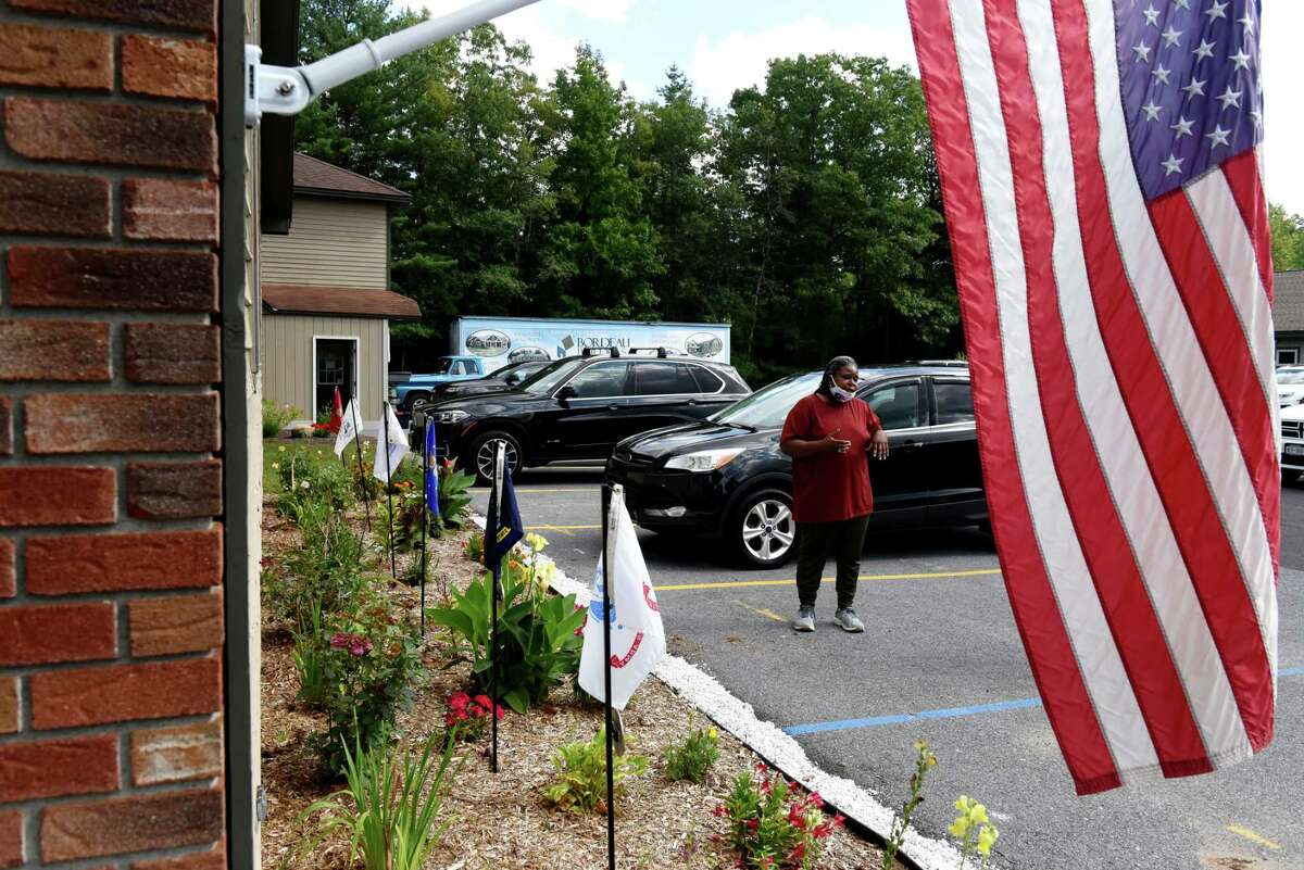 Army veteran Sandra Moody, who served in Afghanistan, points out some of the features in the Saratoga County Veterans Service Agency garden on Tuesday, Aug. 31, 2021, during an interview in Ballston, N.Y.