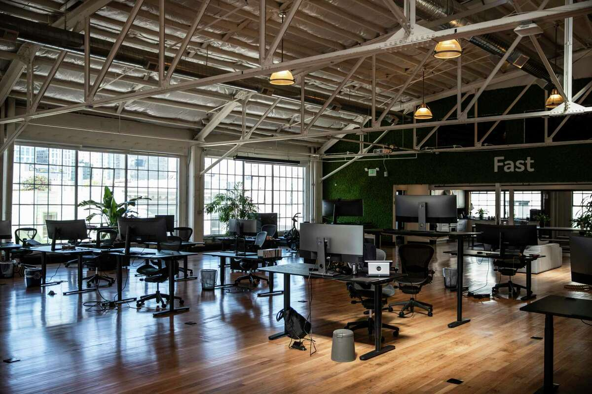 Socially distanced office desks await workers' return at 25 percent capacity in March as San Francisco advances to the orange tier.