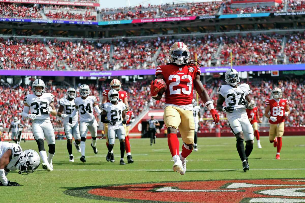 San Francisco 49ers' JaMycal Hasty scores on a 35 yard run in 3rd quarter against Las Vegas Raiders during Niners' 34-10 win in NFL preseason game at Levi's Stadium in Santa Clara, Calif., on Sunday, August 29, 2021.