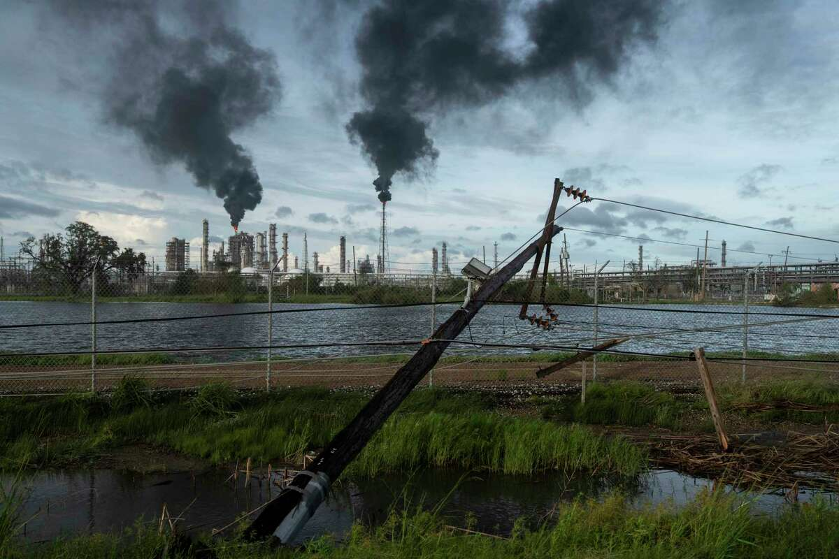 LAPLACE LA - AUGUST 30 Broken power lines, destroyed by Hurricane Ida, are seen along a highway near a petroleum refinery on August 30, 2021 outside LaPlace, Louisiana. Idas eastern wall went right over LaPlace inflicting heavy damage on the area. (Photo by Michael Robinson Chavez/The Washington Post via Getty Images)