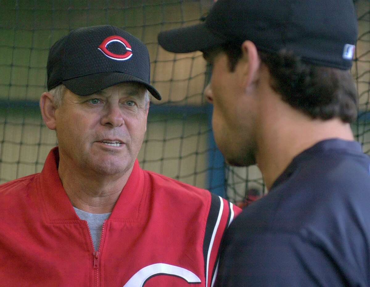 Cincinnati Reds manager Bob Boone, left, talks with his son, Reds third baseman Aaron Boone, in the batting cage at the team's spring training camp in Sarasota, Fla., on Feb. 22, 2002.