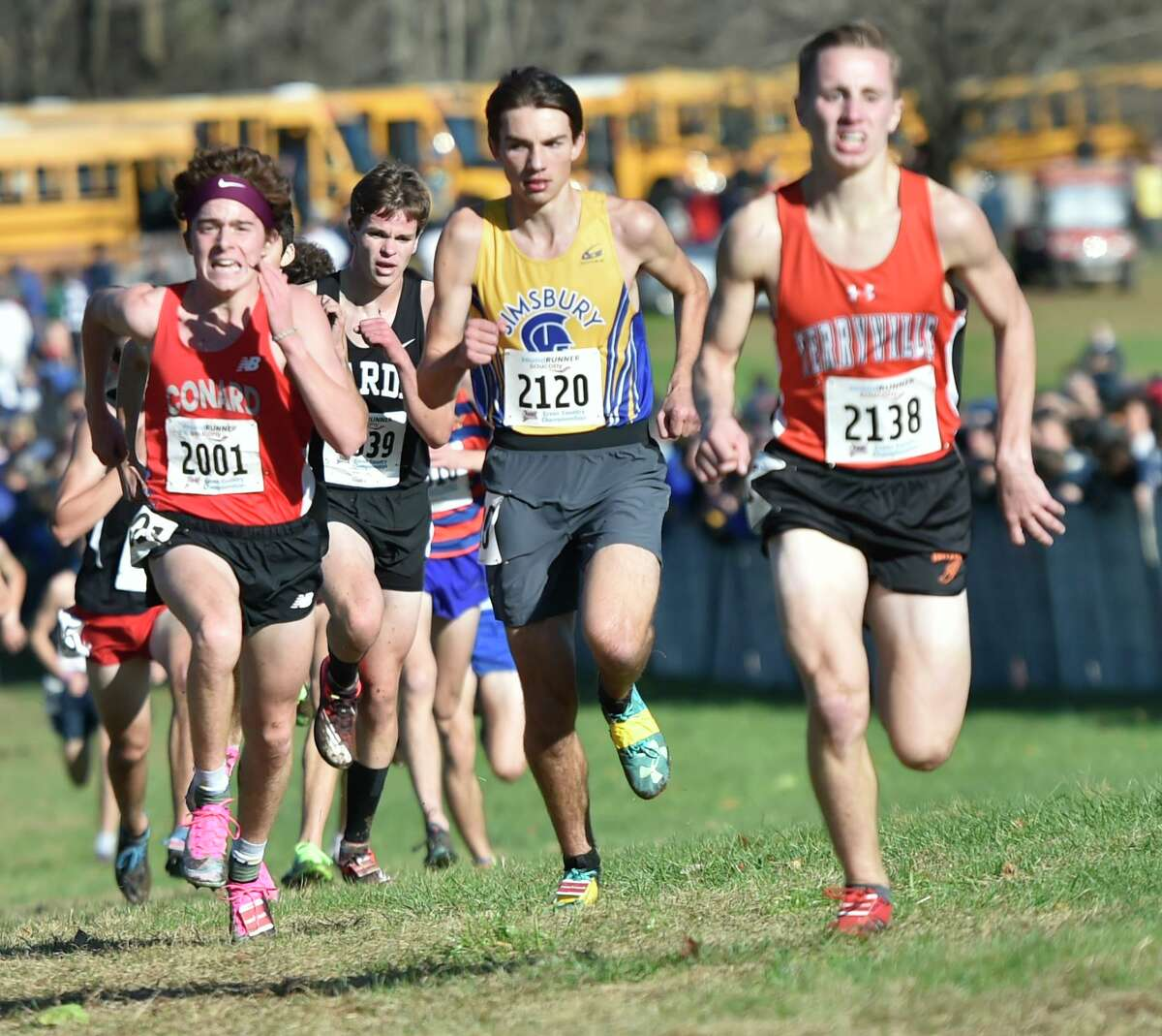 Manchester, Connecticut -Wednesday, November 1, 2019: 9th place finisher Callum Sherry of Conard H.S., 13th place fisher Gregory Vogt of Fairfield Warde H.S., 10th place finisher Owen Wollenberg of Simsbury H.S., and 11th place finisher Chris Deforest of Terryville H.S. , left to right, run toward the finish line during the CIAC Boys Cross Country Open Championship Friday at Wickham Park in Manchester.