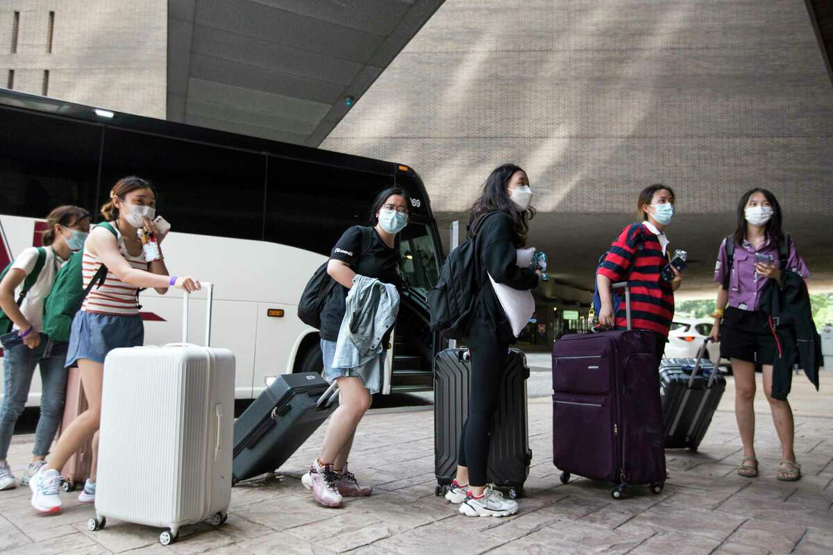 A group of international students from Tulane University are dropped off at the downtown Hyatt after evacuating New Orleans in the aftermath of Hurricane Ida Tuesday, Aug. 31, 2021 in Houston. A total of 1,841 Tulane students were ferried in 35 buses to Houston.