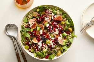 """Honey and apples are a staple to wish celebrants a sweet new year at Rosh Hashanah. Rabbi Leible Morrison explains that all the foods are symbolic of spiritual riches with sweet apple dishes representing a sweet new year and pomegranates being """"new fruits"""" and prosperity. Savory dishes can include this beet and barley salad with date-citrus vinaigrette shown here. (Ryan Liebe/The New York Times)"""
