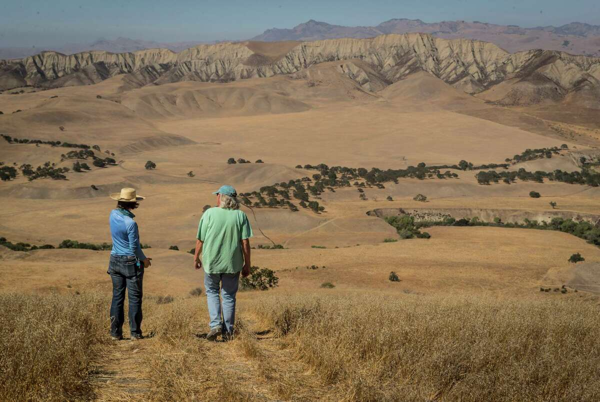 Martha Skelley, farm and livestock manager, and owner Sallie Calhoun chat at the Paicines Ranch, near Paicines, Calif., on Tuesday, August 17, 2021. Calhoun owns the ranch, which specializes in raising grass-fed sheep and a vineyard. The ranch's operations have been severely affected by the drought because she relies on rain to irrigate the pastures and groundwater from an aquifer to irrigate her vineyard.