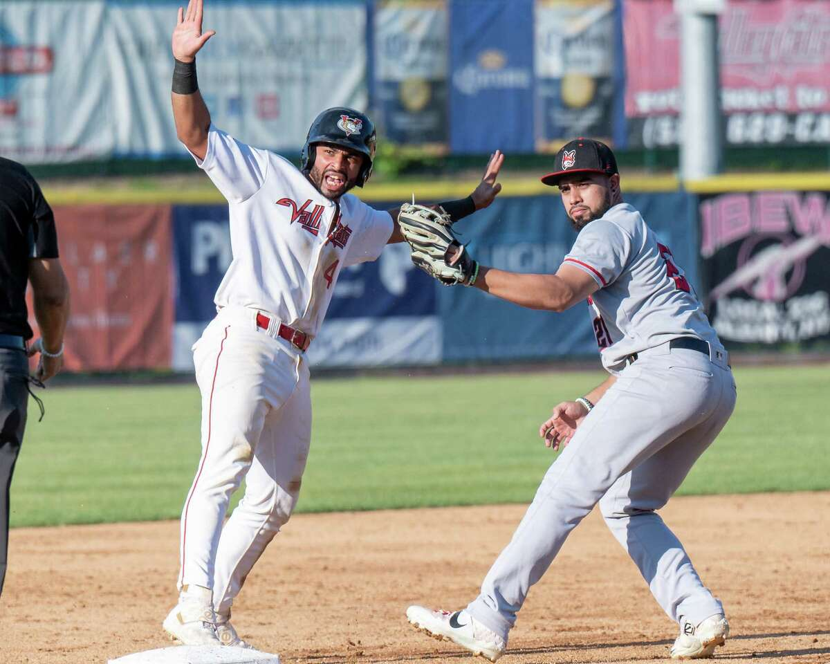 Tri-City ValleyCats second baseman Luis Roman slides into third in front of New Jersey Jackals third baseman Stanley Espinal at the Joseph L. Bruno Stadium on the Hudson Valley Community College campus in Troy, NY, on Tuesday, Aug. 31, 2021. (Jim Franco/Special to the Times Union)