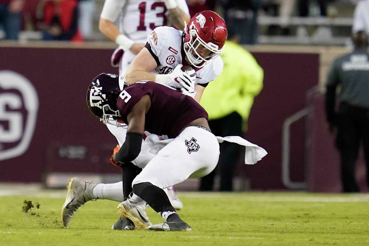 Texas A&M safety Leon O'Neal Jr., tackling Arkansas' Henry Hudson last season, brings a unique passion to the game.