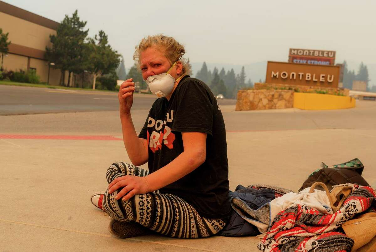 Nancy Mark, an unhoused woman originally from Virginia, sits outside the Montbleu Resort in Stateline, Nev., as the anticipates being evacuated on Tuesday, August 31, 2021.