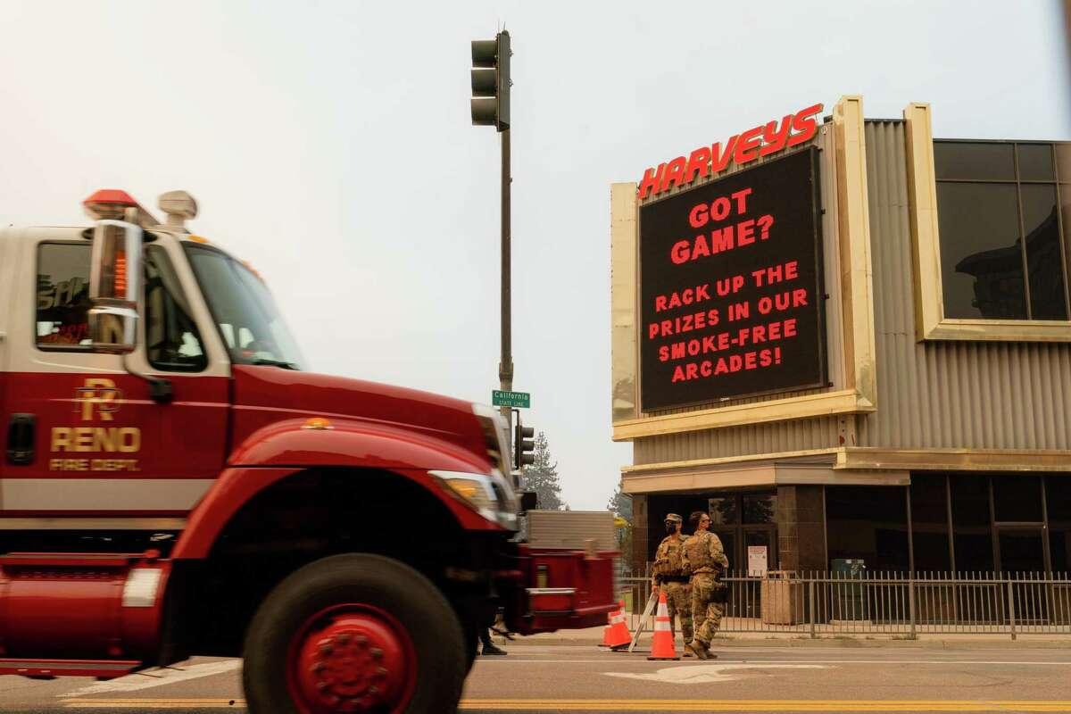A fire engine from the Reno Fire Department drives past a checkpoint operated by the California Highway Patrol and National Guard in front of Harveys Lake Tahoe in Stateline, Nev.