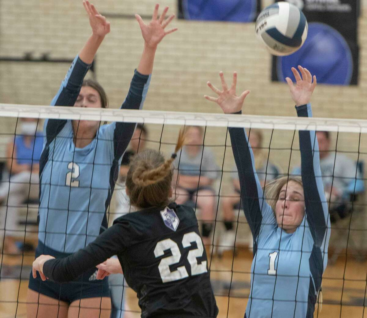 Midland Classical's Emma Westfall gets the hit over the reach of Greenwood' Kylee Whisman and Kenli Bales 08/31/2021 at Greenwood High School. Tim Fischer/Reporter-Telegram