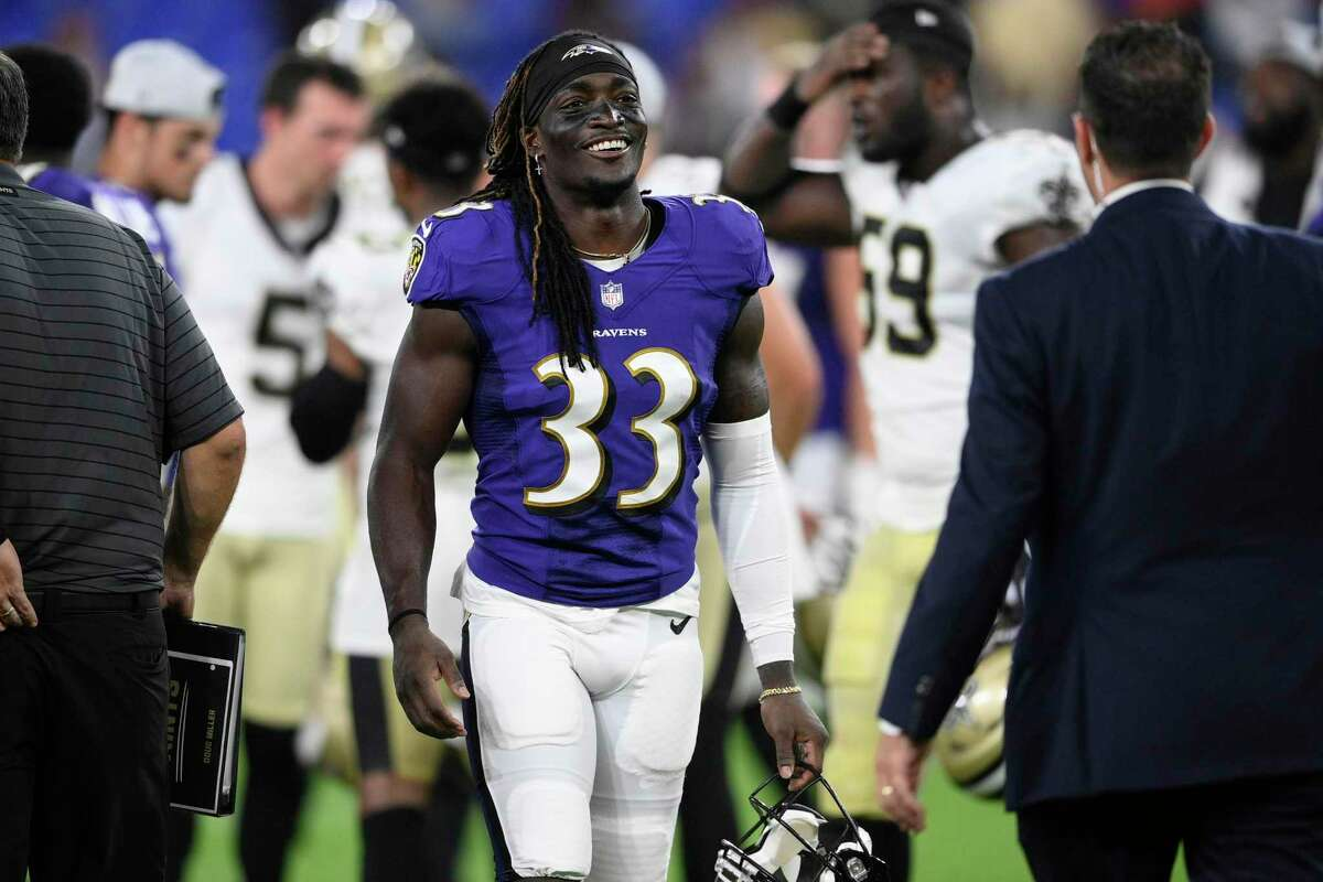 Baltimore Ravens cornerback Davontae Harris (33) smiles after an NFL preseason football game against the New Orleans Saints, Saturday, Aug. 14, 2021, in Baltimore. (AP Photo/Nick Wass)