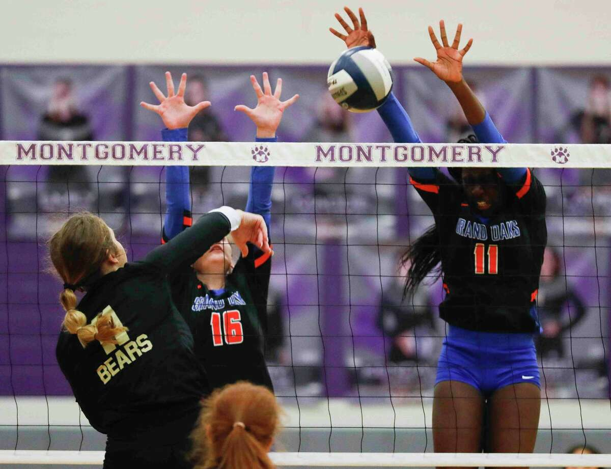 Montgomery outside hitter Abby Meador (11) has her shot blocked by Grand Oaks middle blocker Jaela Auguste (11) in the first set of a high school volleyball match at Montgomery High School, Tuesday, Aug. 31, 2021, in Montgomery.