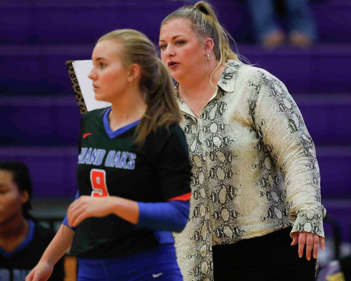 Grand Oaks head coach Morgan Rogers instructs her team in the second set of a high school volleyball match at Montgomery High School, Tuesday, Aug. 31, 2021, in Montgomery.