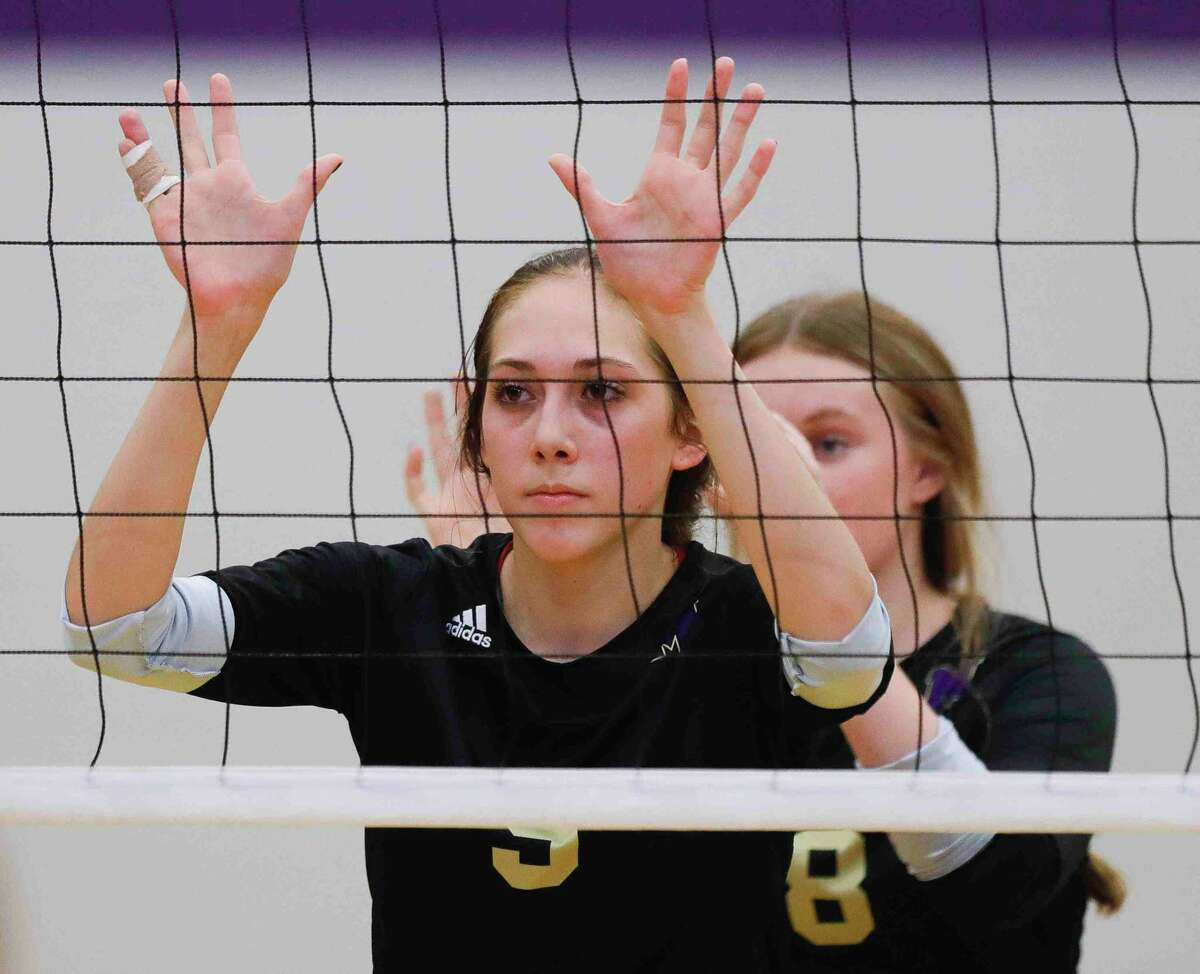 Montgomery middle blocker Taryn McAnally (8) awaits a serve beside outside hitter Mckenzie Hope (9) in the second set of a high school volleyball match at Montgomery High School, Tuesday, Aug. 31, 2021, in Montgomery.