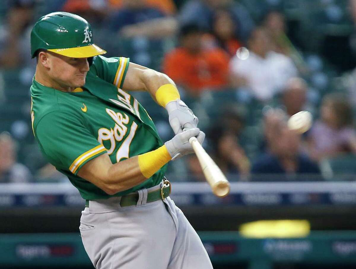 Matt Chapman hits a two-run home run in the third inning. Oakland has won 23 of the past 24 games against the Tigers.