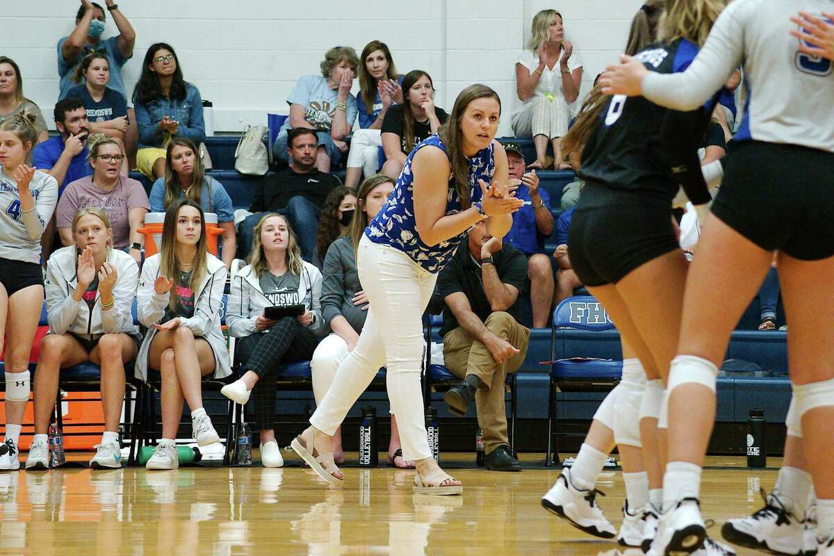 Friendswood volleyball coach Sarah Paulk watched the Lady Mustangs improve to 2-0 in District 22-5A matches Tuesday with a win over Galveston Ball.